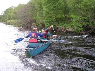 Learning to break out - canoeing skills above Spey Bridge, Newton More.